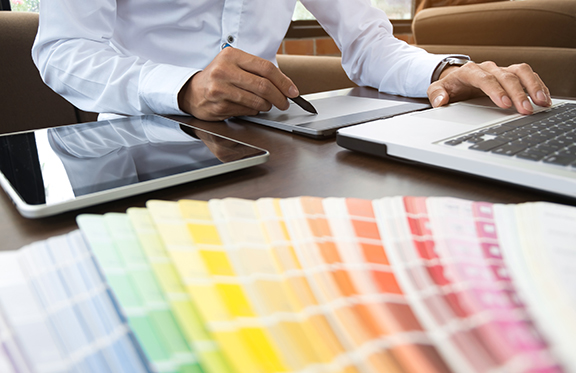 Graphic designer job with colour charts at a modern office